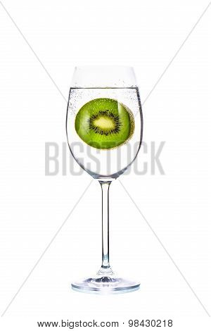 Slices Of Kiwi Fruit And Bubble In Glass On White Background