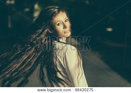 Colorized image of long haired women shaking her beautiful hair