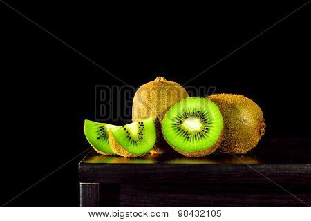 Still life with Kiwi fruit on the table and black background, lowkey light