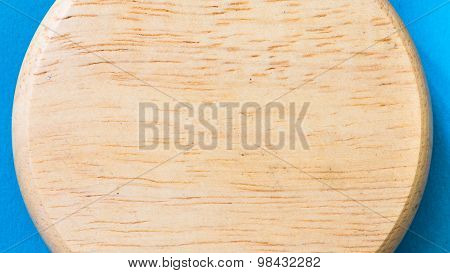 Wooden bord on blue paper background