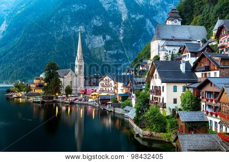 Classic view of Hallstatt village in Alps at dusk, Austria