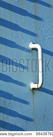 White Handle Blue Shadows Concrete