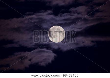 Moon illuminates the clouds
