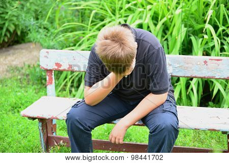 Depressed Teenager Sitting On The Bench