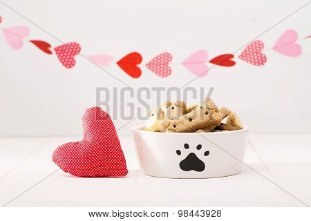Dog Treats On A White Bowl With A Heart Cushion