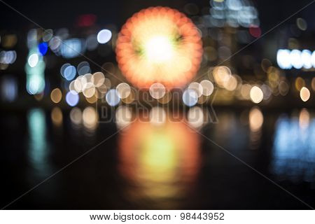 Blurred Bokeh Night Harbor Lights Background With Ferris Wheel