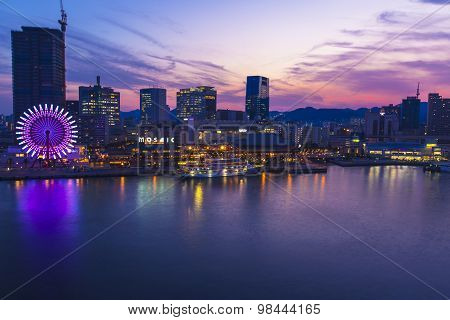 Kobe Harbor At Night With Ferris Wheel And Boat