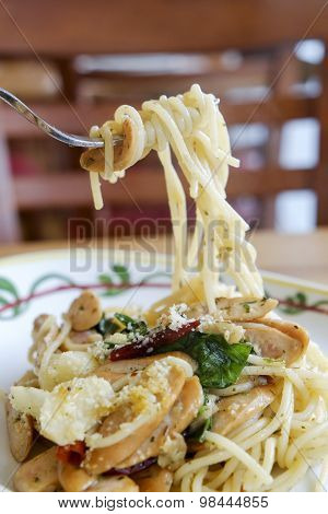 Fork With Spicy Spaghetti With Sausage