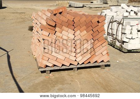 Exactly combined pile of a red brick