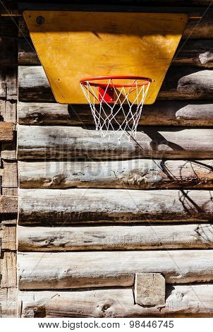 Basketball Hoop Hanging On The Wall Of A Wooden House