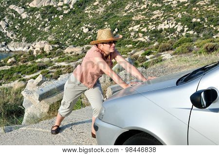 Woman pushing and trying to stop the car