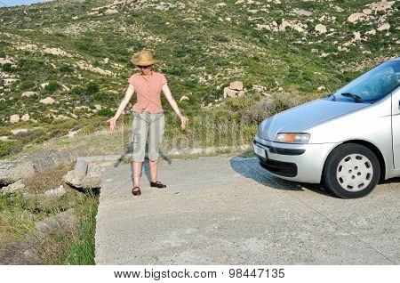 Woman stopping the car and showing to the end of the road