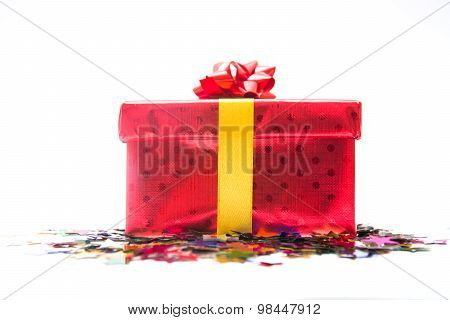 Red gift box with confetti