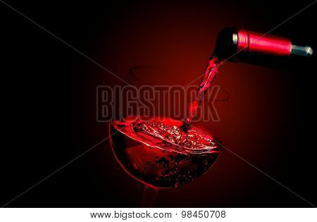 Barman Pouring Red Wine In The Glass