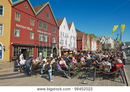 People have lunch at street restaurants at Bruggen in Bergen, Norway.