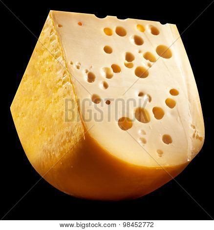 Emmental cheese head quater on a black background.