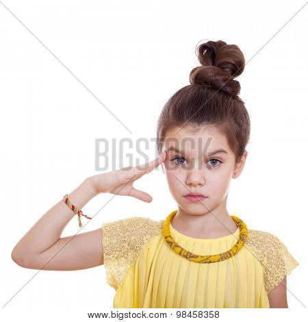 Teenager salutes, his hand on his head, studio on white background
