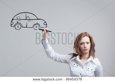 Young woman drawing car, concept on the subject of dreams or financial planning