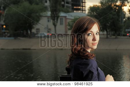 Calm water, calm redhead women look back copyspace.