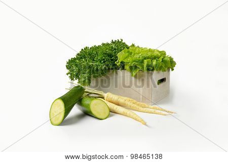 box of lettuce, courgette and white parsley on white background