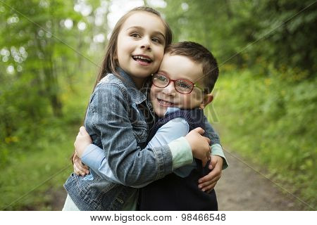 Portrait of two cute little child outdoors on the nature