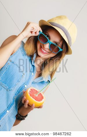 Summer. Girl Tourist Drinking Grapefruit Juice