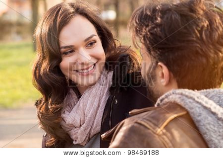 Portrait of happy couple looking at each other and smiling outdoor