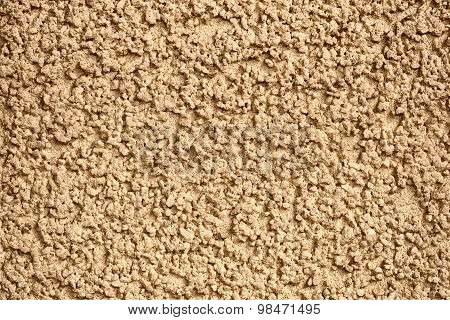 Yellow concrete wall with plaster.