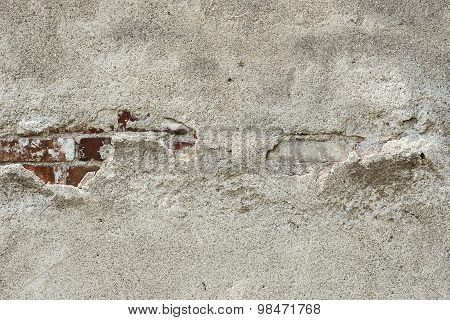Old cement plaster and old red brick