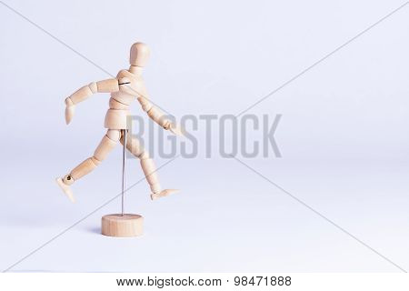 Wooden Mannekin On White Background