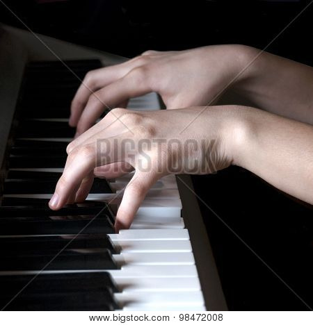 Hands playing synthesizer