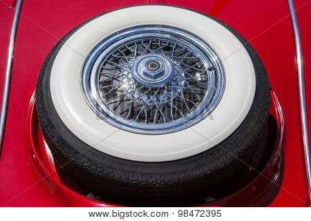 Spare tire on an red retro car