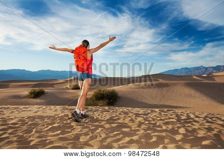 Girl with straight arms standing in Death valley