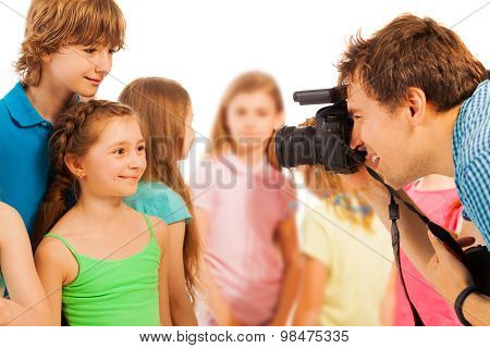 Professional photographer photographing kids