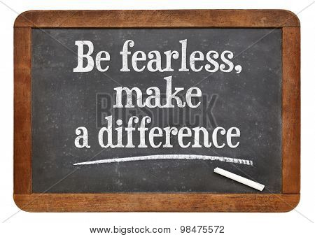 Be fearless, make a difference  - motivational text  on a vintage slate blackboard