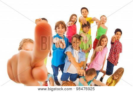 Funny group of kids pointing fingers