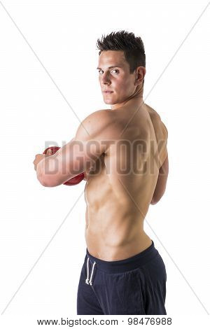 Handsome young man holding weight disc