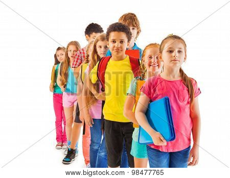 Group of boys and girls standing in the queue