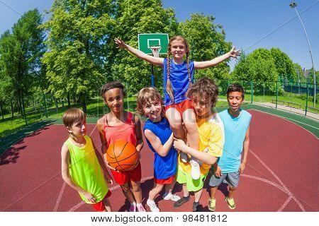 Girl on shoulders of her team after basketball
