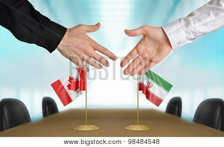 Canada and Iran diplomats agreeing on a deal