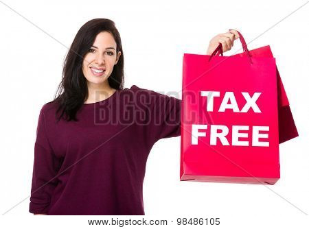 Caucasian woman show with shopping bag and showing tax free