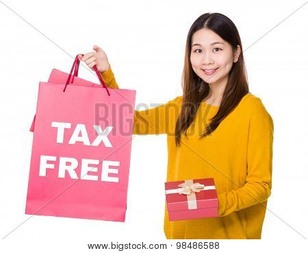 Woman hold shopping bag and gift box with showing tax free
