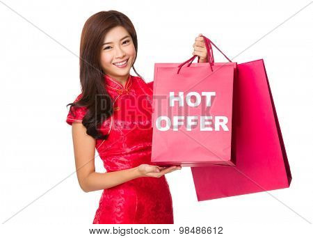 Chinese Woman hold with red paper bag and showing hot offer