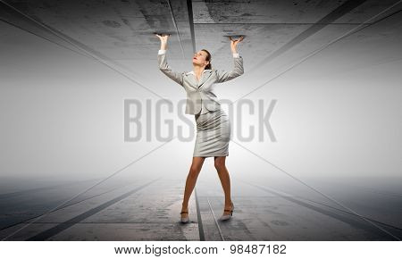 Businesswoman under pressure between two stone walls