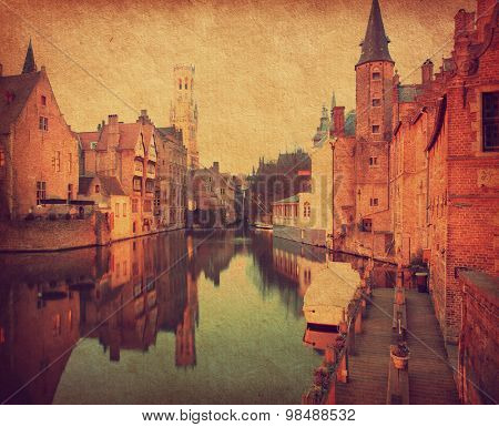 Bruges historic centreat the evening , Belgium. Photo in retro style. Added paper texture. Toned image