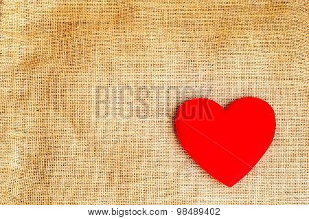 Red Heart On Gunny Sackcloth Texture Background With Grunge Retro Tone