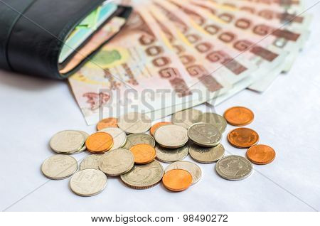 Close Up Of Thailand Money Bath With Black Wallet On White Background