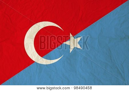 Flag Of Turkey And Uyghurs With Vintage Old Paper