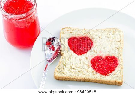 Whole Wheat Bread With Heart Shape Of Strawberry Jam In White Plate