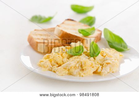 Breakfast With Scrambled Eggs And Toasts.